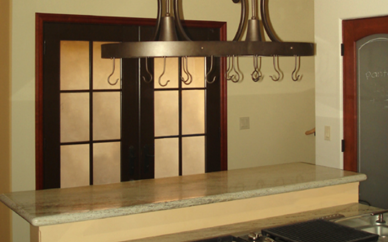 Remodeled kitchen with hanging rack